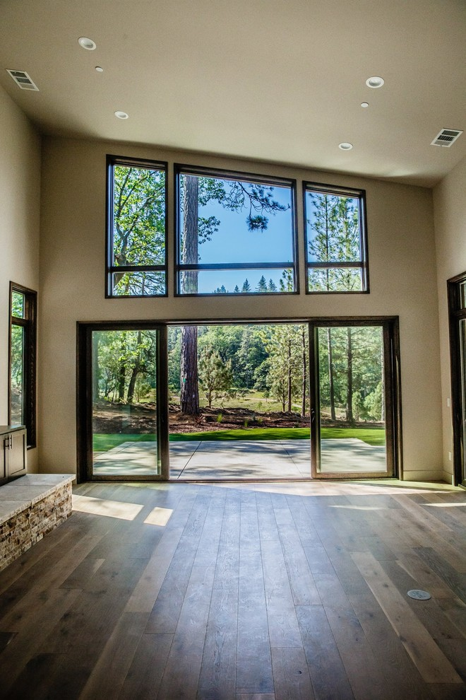 Inspiration for a mid-sized contemporary enclosed dark wood floor and brown floor family room remodel in Sacramento with beige walls