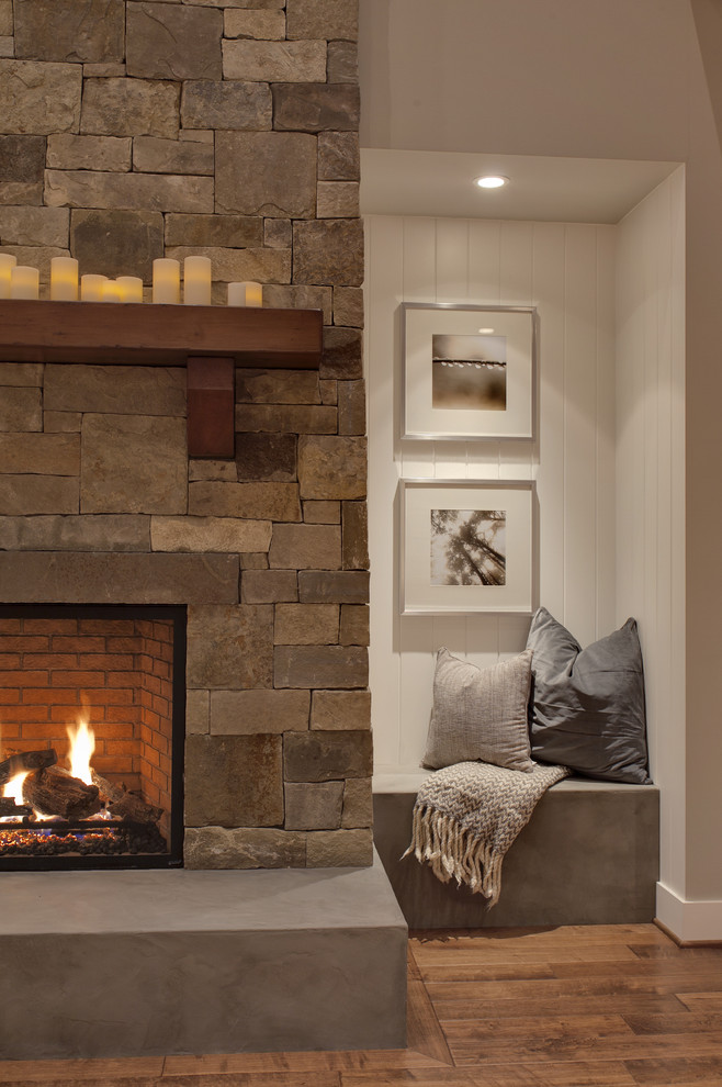 Inspiration for a transitional family room remodel in Seattle with white walls