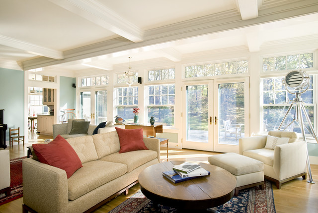 Inspiration for a timeless medium tone wood floor family room remodel in Boston with blue walls