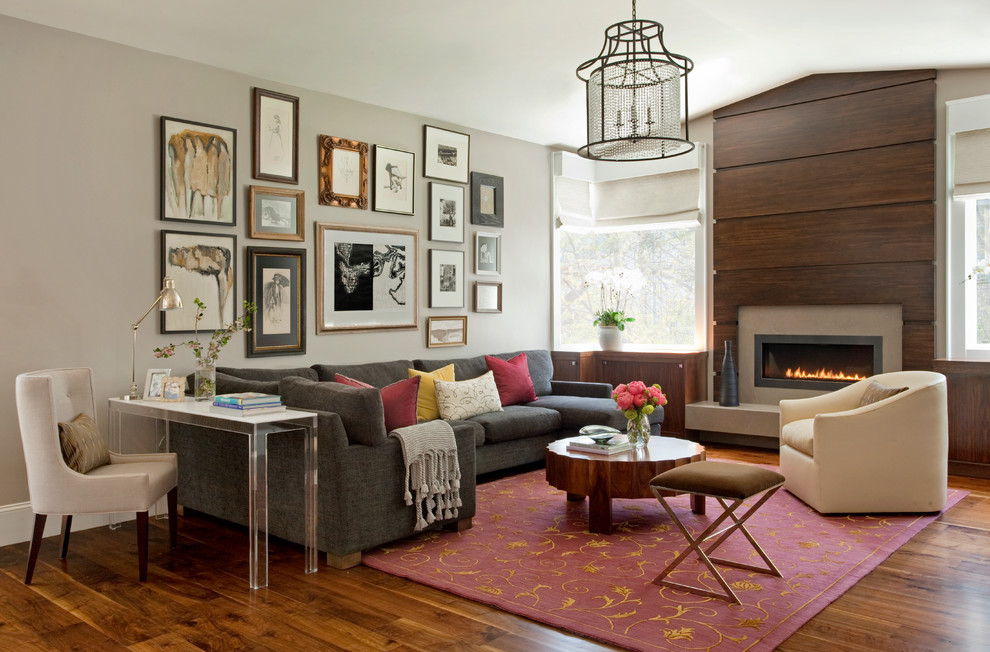 Inspiration for a large contemporary dark wood floor and gray floor family room remodel in San Francisco with a wood fireplace surround, gray walls and a ribbon fireplace