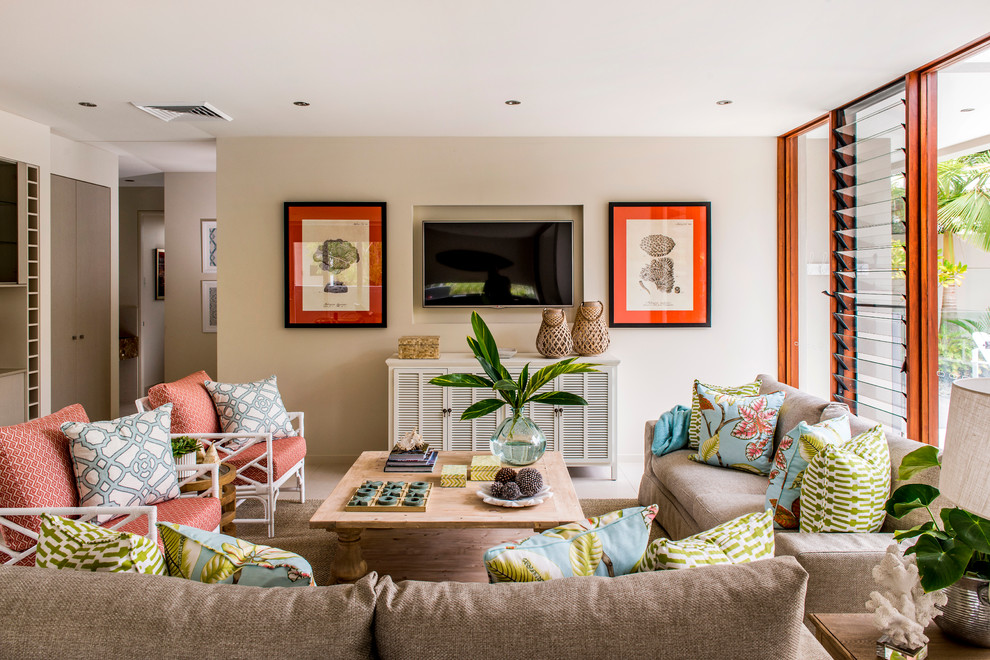 Inspiration for a coastal family room remodel in Brisbane with beige walls, no fireplace and a wall-mounted tv