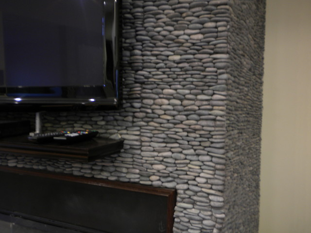 Zen Paradise Standing Pebble Tile Installations contemporary-family-room