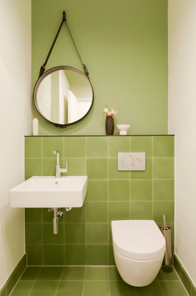 Small trendy green tile and porcelain tile porcelain tile powder room photo in Frankfurt with a wall-mount sink, a wall-mount toilet and green walls