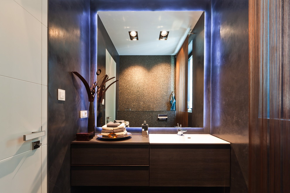 Inspiration for a contemporary powder room remodel in Frankfurt with flat-panel cabinets, a drop-in sink, wood countertops, brown walls, dark wood cabinets and brown countertops