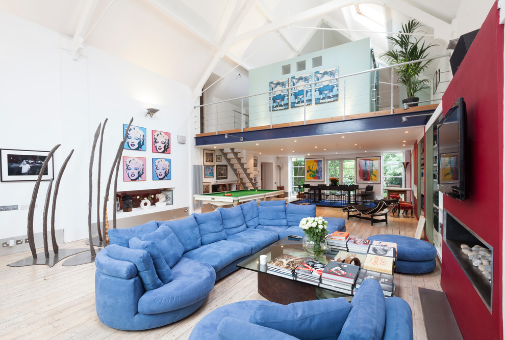 Example of a trendy family room design in London with white walls
