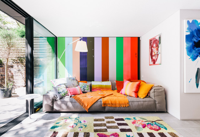 Example of an eclectic family room design in London