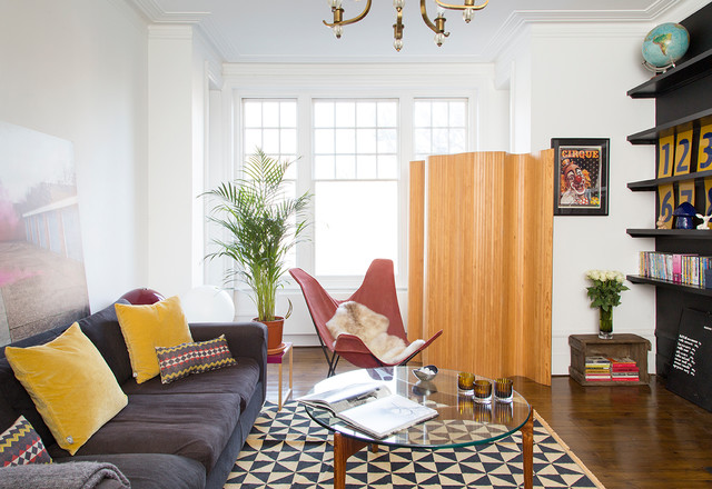 Bohemian family and games room in Other with white walls, dark hardwood flooring, no fireplace and brown floors.