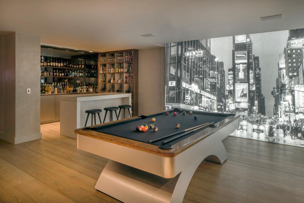 Example of a trendy light wood floor and beige floor family room design in London