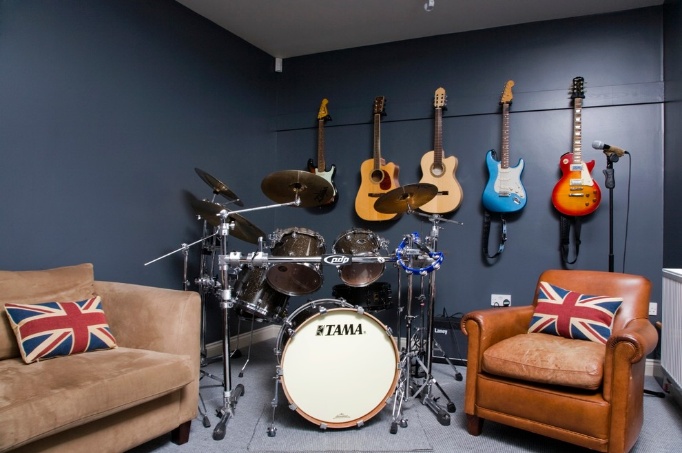Family room - contemporary carpeted family room idea in Gloucestershire with a music area and blue walls
