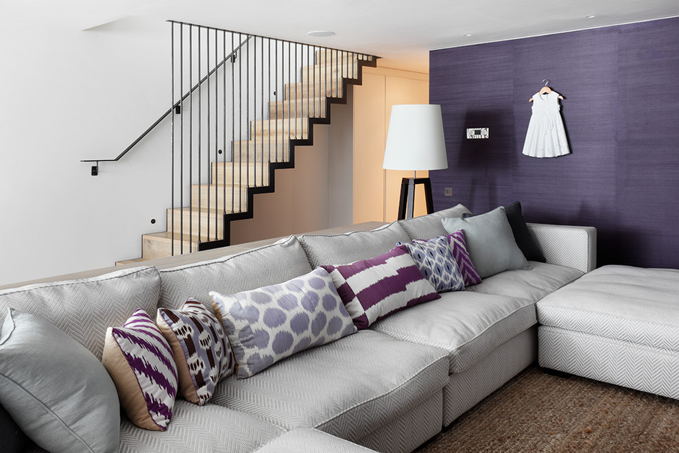 Family room - contemporary open concept family room idea in London with purple walls