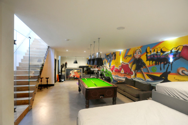 Inspiration for a contemporary concrete floor family room remodel in Oxfordshire with multicolored walls and no fireplace