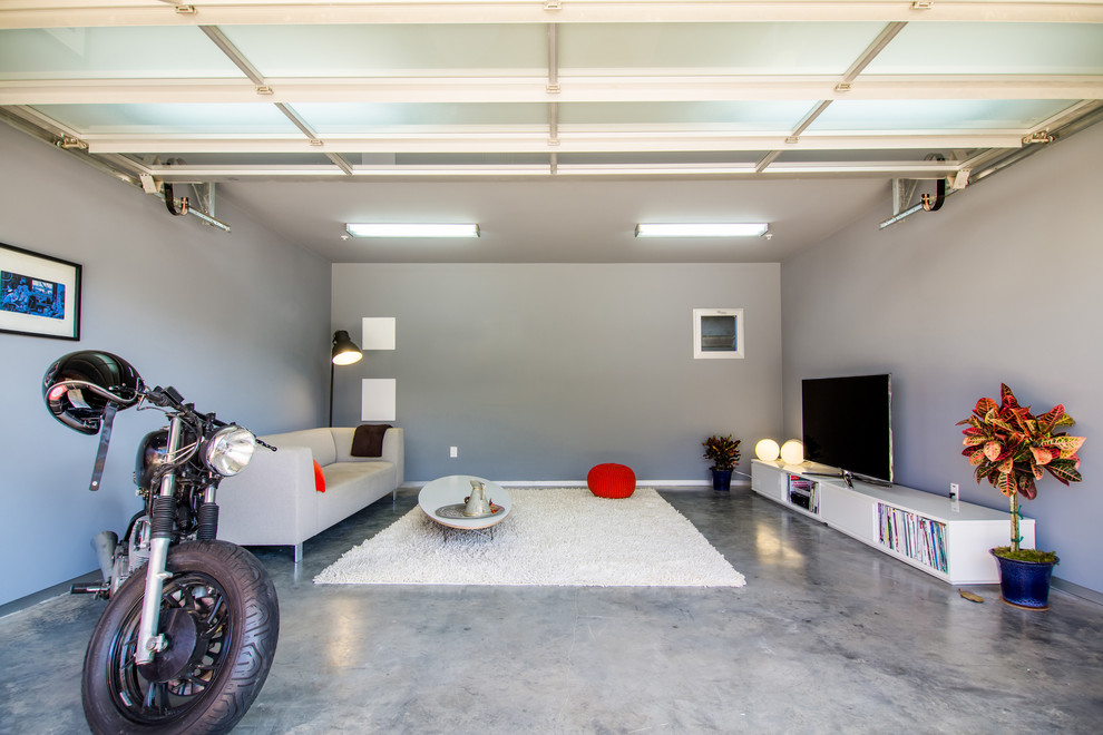 Example of a trendy two-car garage design in Los Angeles