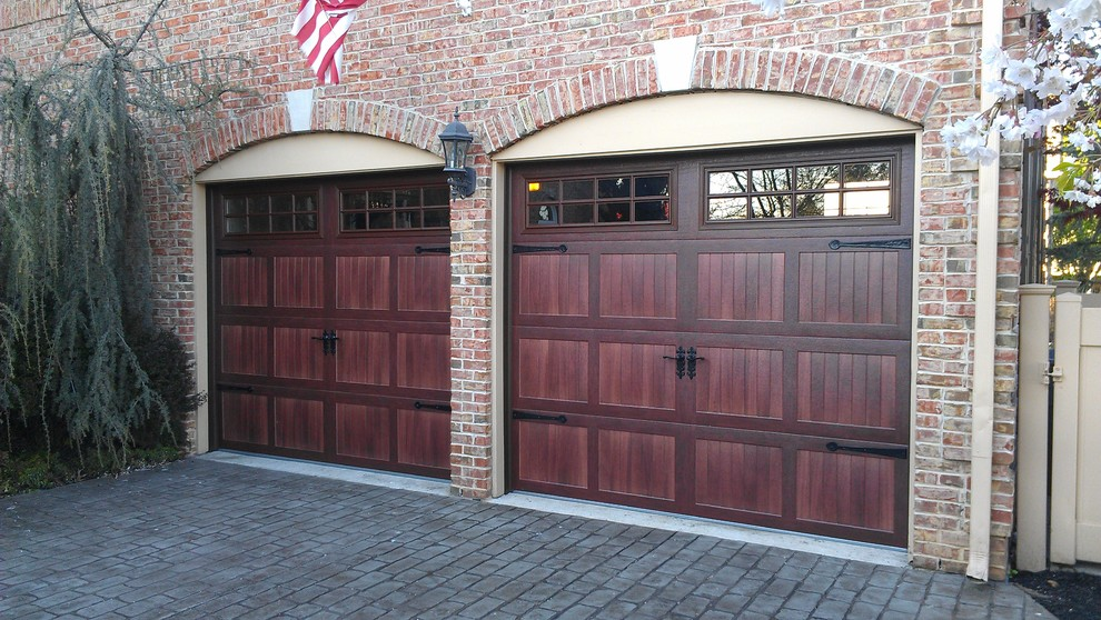 Mid-sized elegant attached two-car garage photo in New York