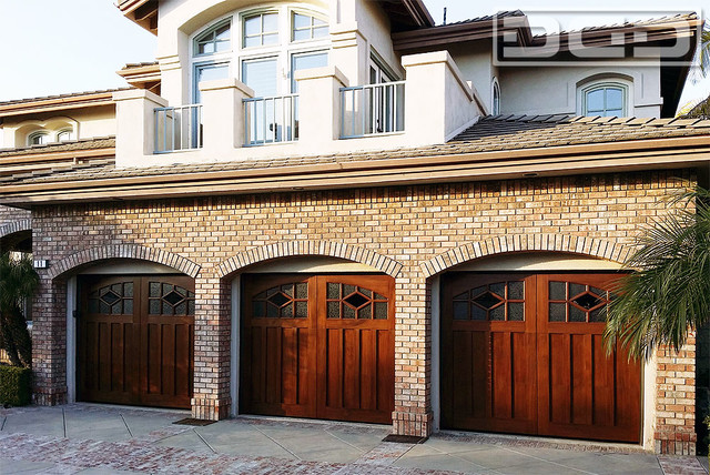 An arts crafts style custom wood garage door with for Arts and crafts garage