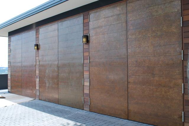 Cowart door copper clad swing doors with patina
