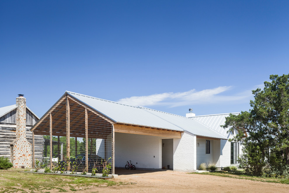 Inspiration for a farmhouse garage remodel in Austin