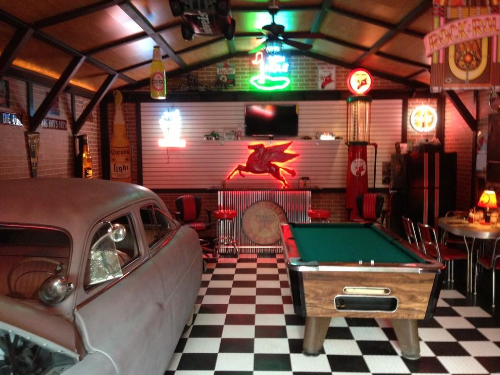Mid-sized elegant detached three-car garage photo in Other