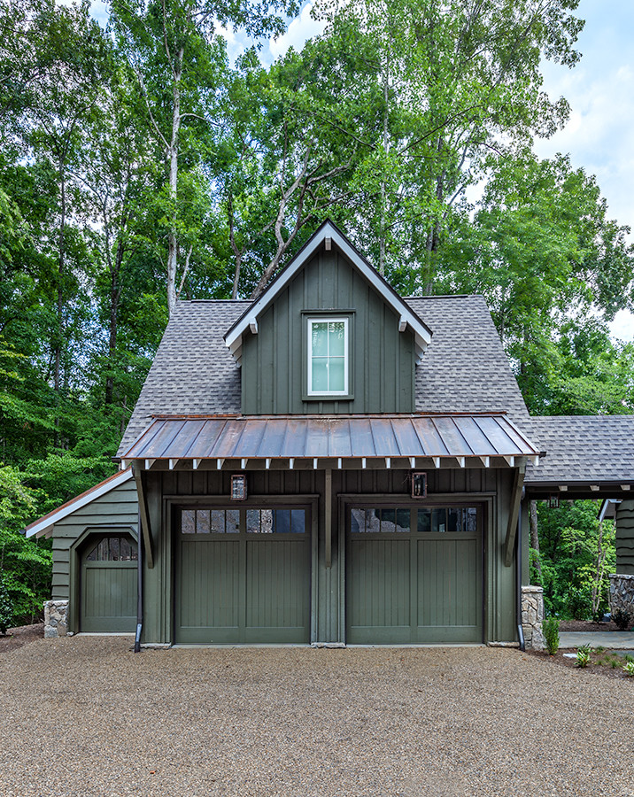 Inspiration for a large cottage attached two-car garage workshop remodel in Other
