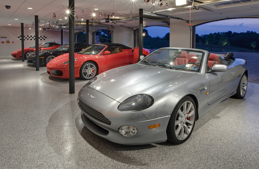 Inspiration for a contemporary four-car garage remodel in Other