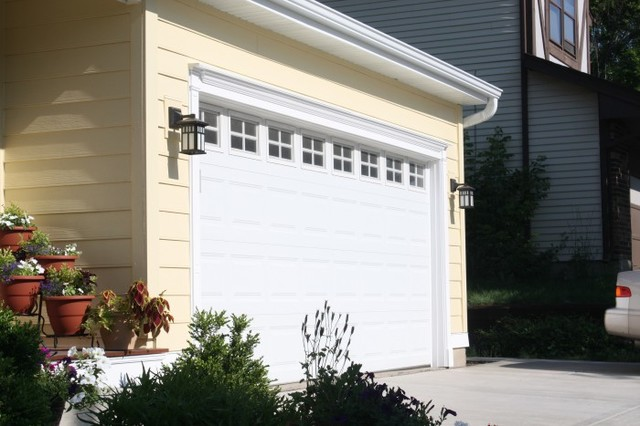 Cape cod style yellow siding white trim black shutters for Cape cod garage doors