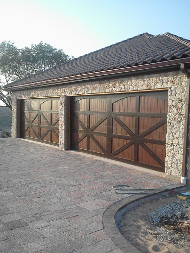 Cedar wood overhead garage doors rustic garage for Rustic wood garage doors