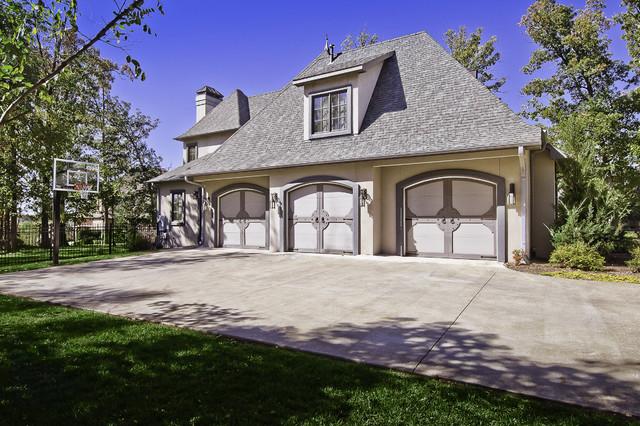 Celtic custom garage doors traditional garage and shed for Little rock custom home builders