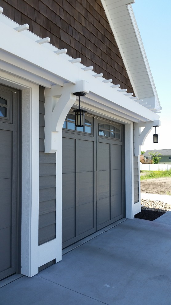 Garage - mid-sized craftsman attached two-car garage idea in Other