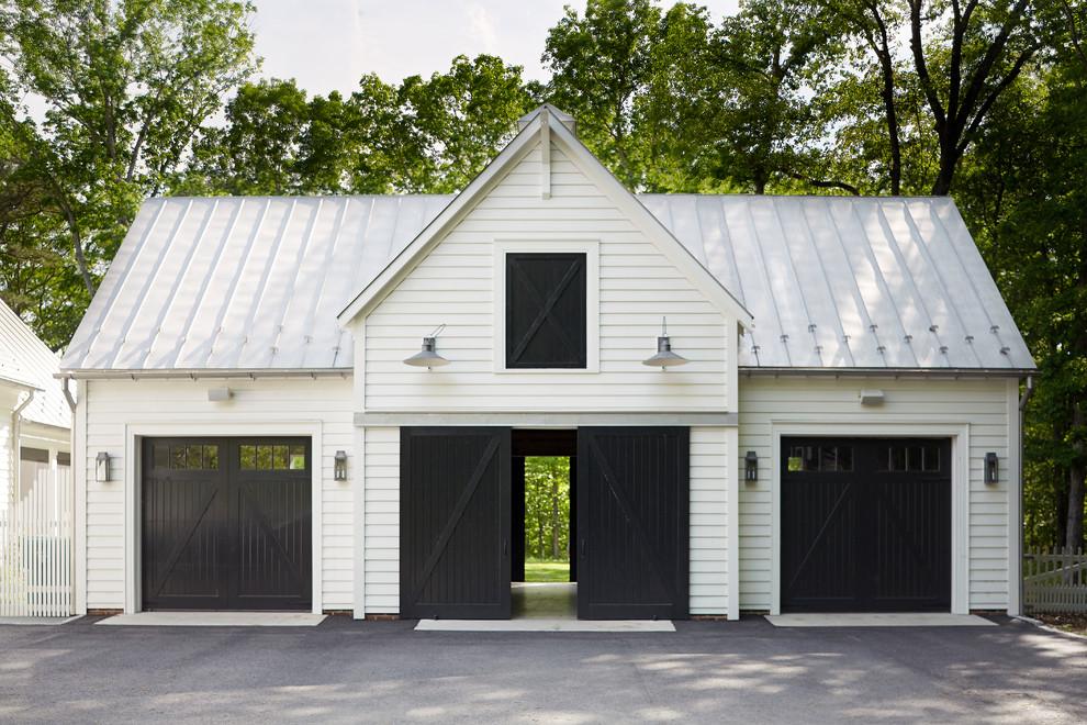 Farmhouse detached three-car garage photo in Richmond