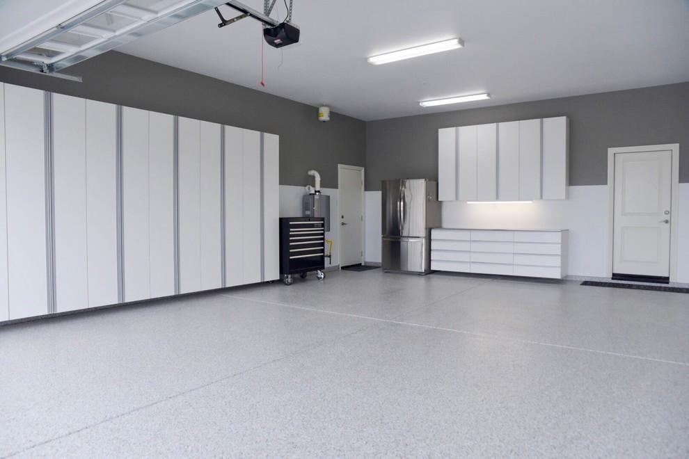 Garage - large modern two-car garage idea in Other