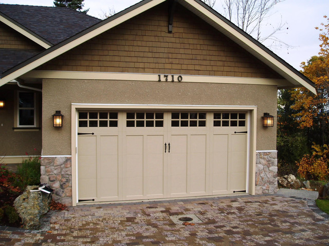 Clopay coachman collection carriage house garage door for Craftsman style garage lights