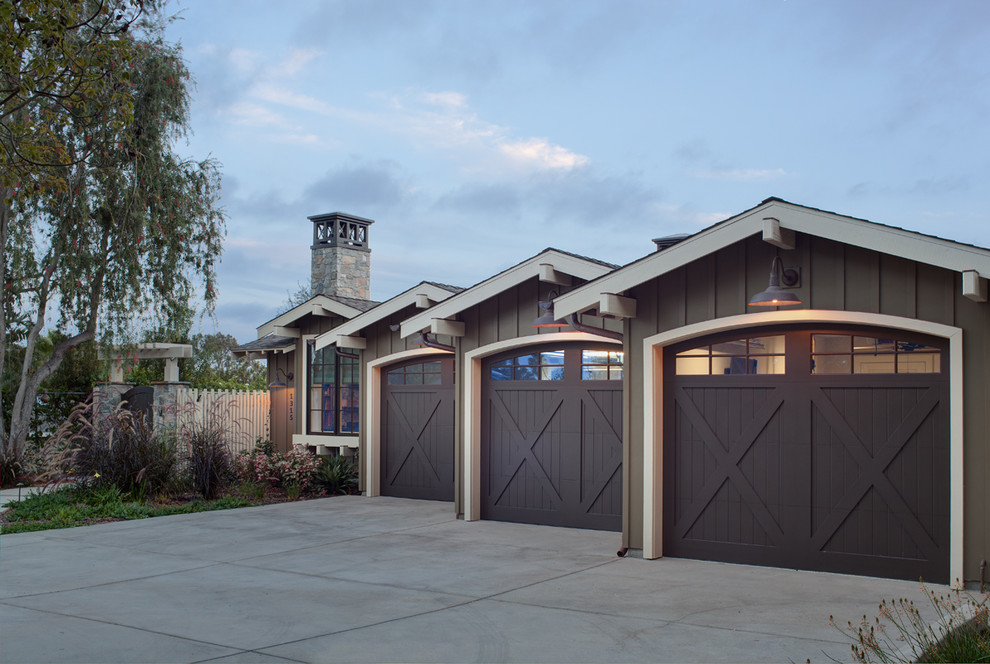 Inspiration for a farmhouse attached three-car garage remodel in San Diego