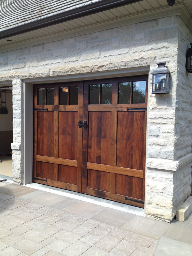 Example of an arts and crafts garage design in Toronto