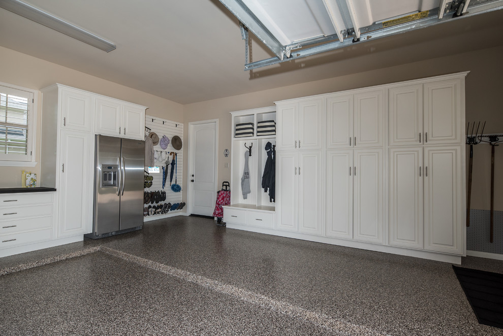 Inspiration for a large timeless garage remodel in Houston