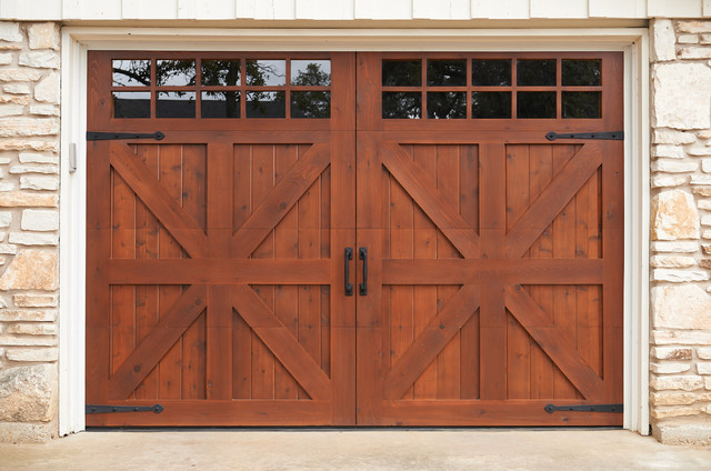 Custom garage door farmhouse garage by sikkens for Farmhouse garage doors