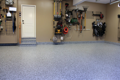 an epoxy floor coating is one of our garage ideas, to help keep the space cleaner