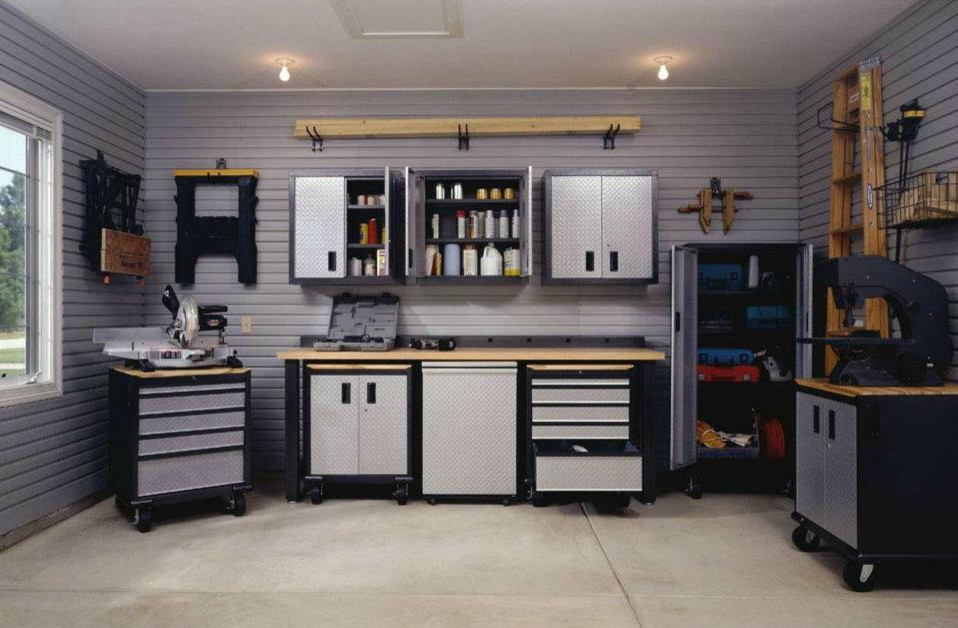 Mid-sized urban attached two-car garage workshop photo in Toronto