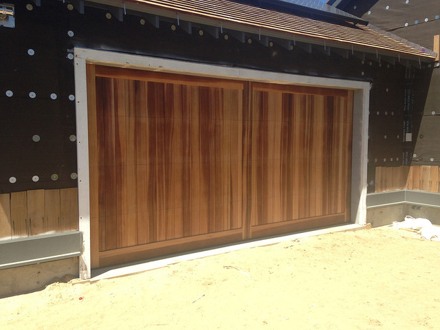 Custom wood garage doors rustic garage new york by for Rustic wood garage doors