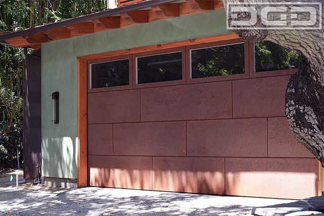 Dynamic Garage Door Design With Corten Steel Cladding Windows