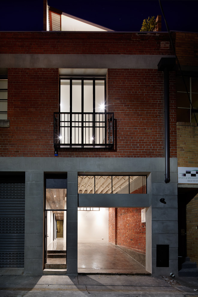 Example of an urban attached garage design in Melbourne