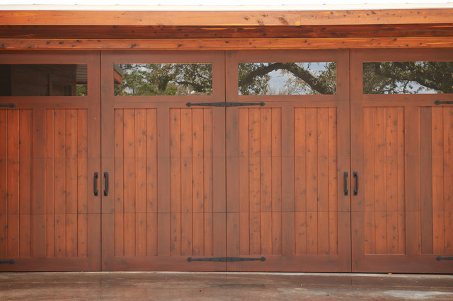 Farmhouse style garage doors farmhouse garage by for Farmhouse garage doors