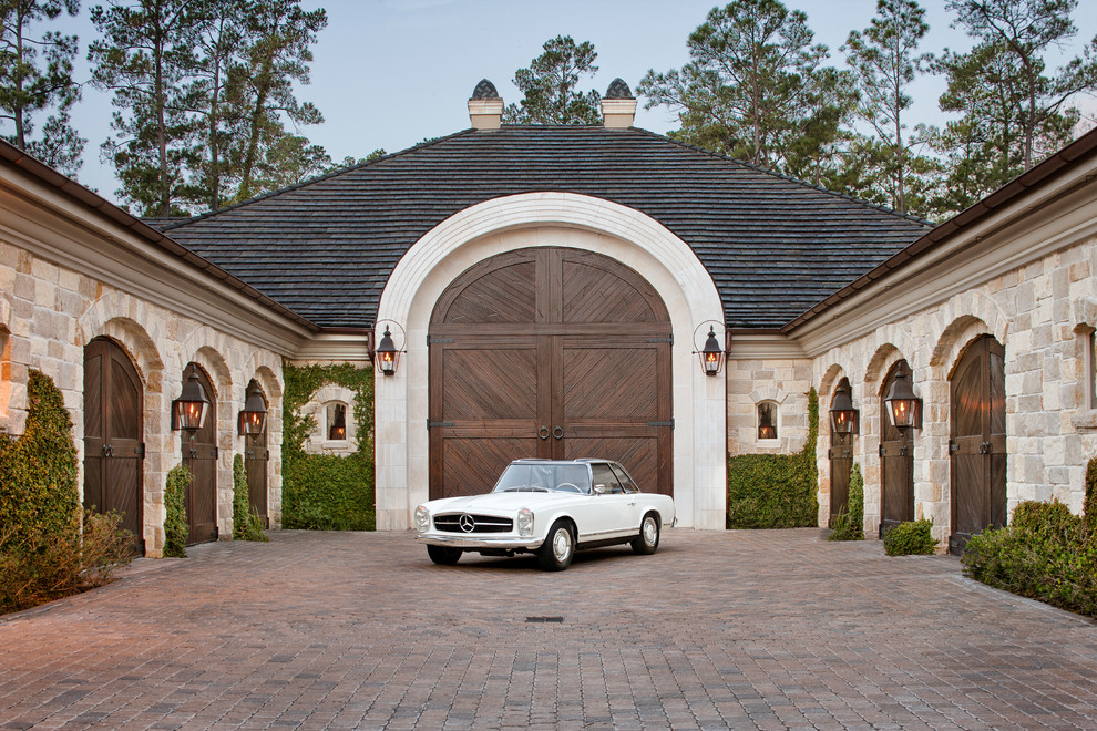 Inspiration for a timeless four-car garage remodel in Houston