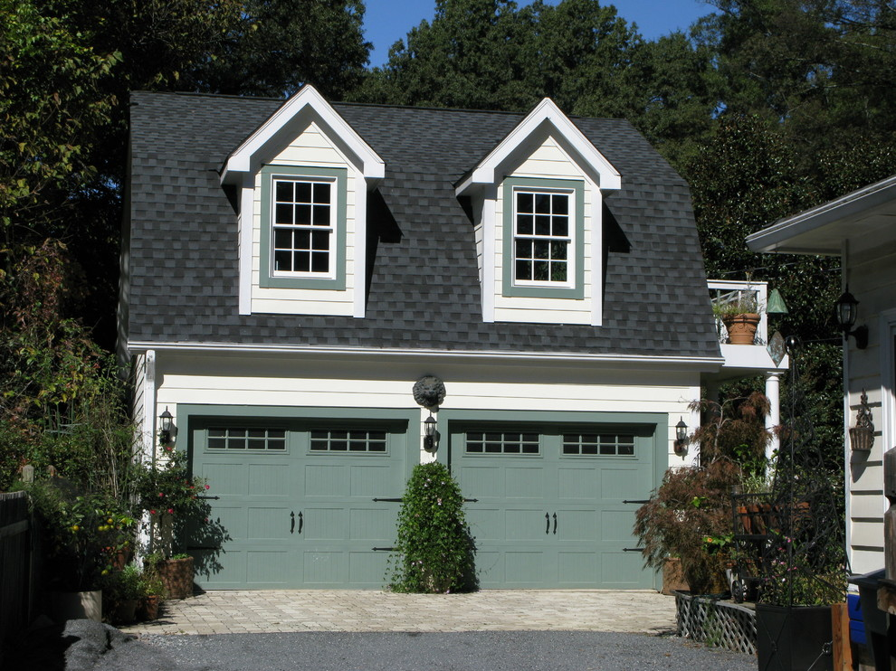 Example of a classic detached two-car garage design in Charlotte