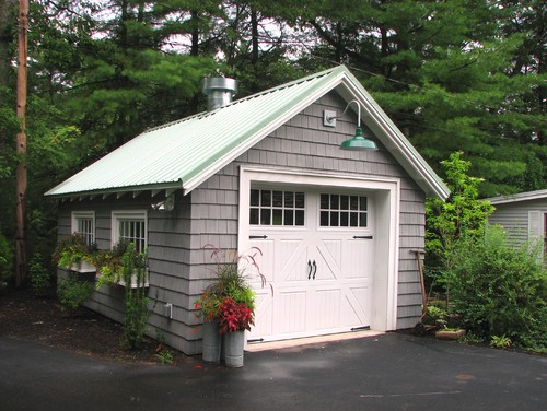 Freshen up your home 39 s curb appeal this spring for Traditional garage