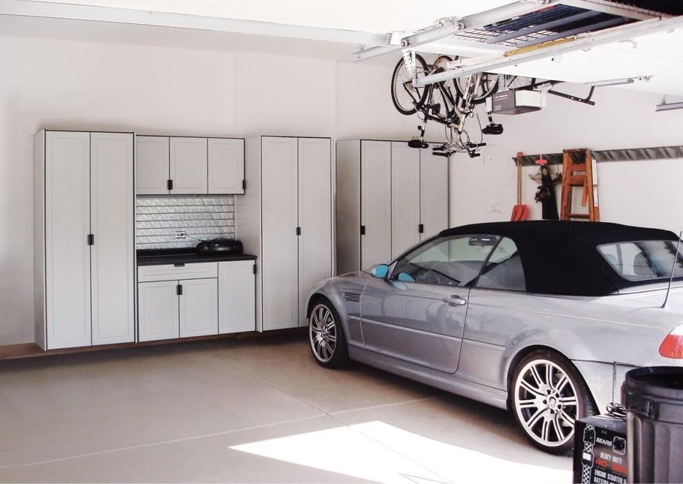 Large transitional two-car garage workshop photo in Kansas City