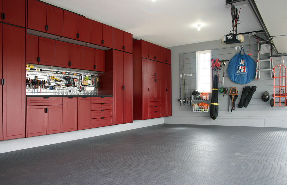 Large transitional attached two-car garage workshop photo in Kansas City