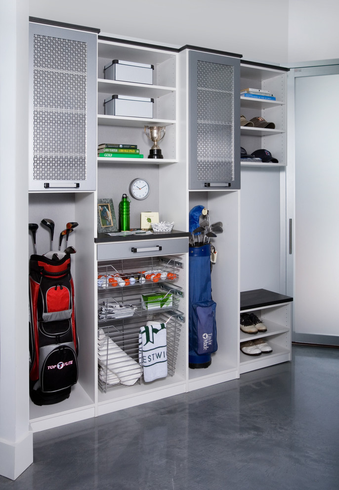 Inspiration for a mid-sized modern attached garage workshop remodel in New York