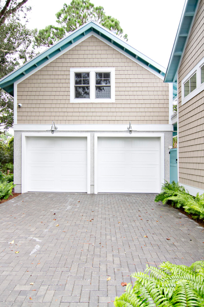 Large island style detached two-car carport photo in Jacksonville