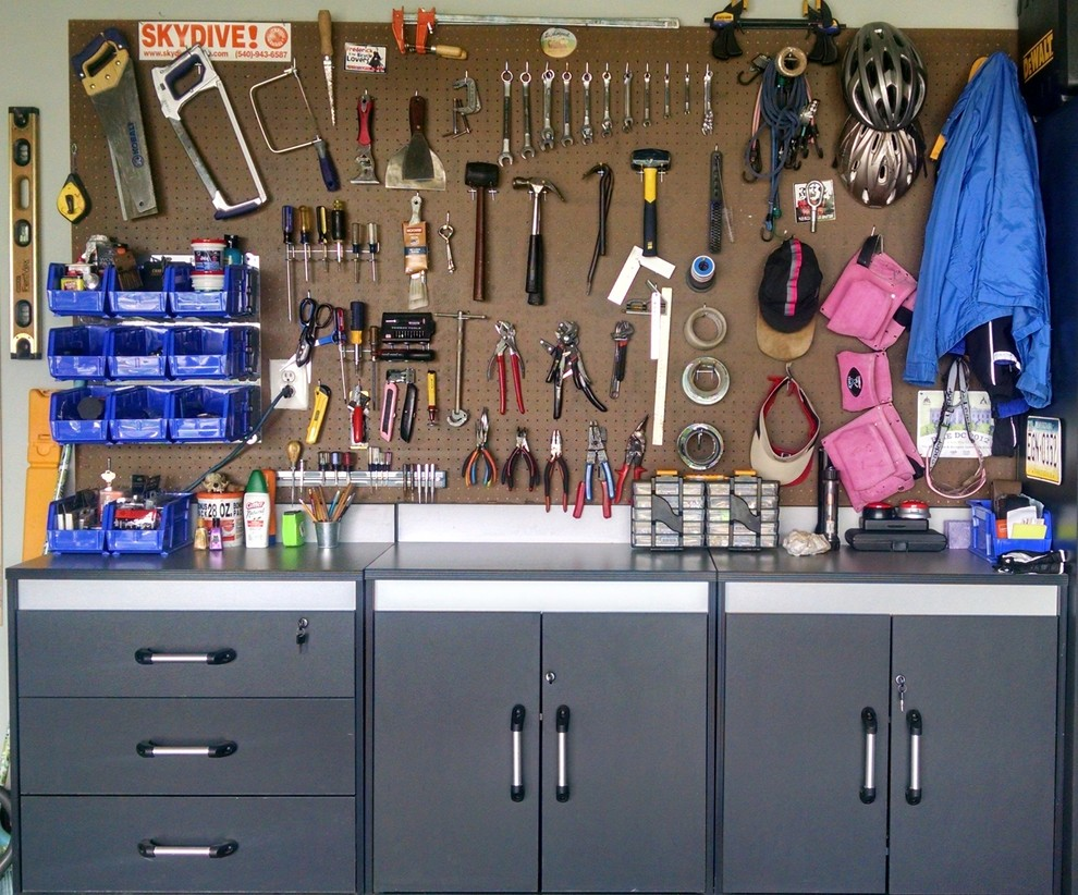 Inspiration for a mid-sized industrial two-car garage remodel in DC Metro