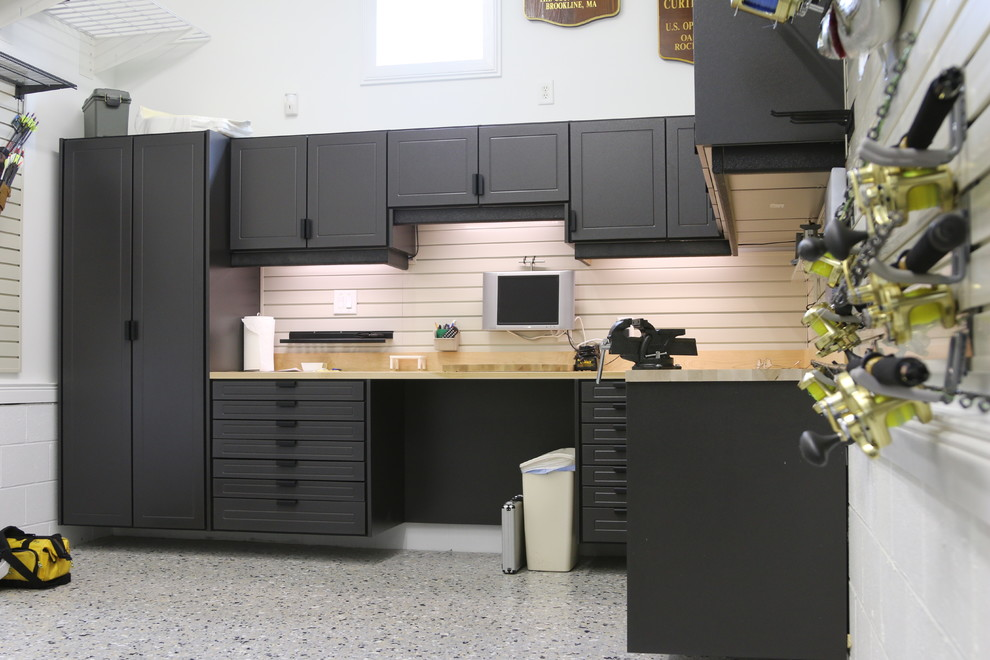 Inspiration for a mid-sized transitional attached one-car garage workshop remodel in Other
