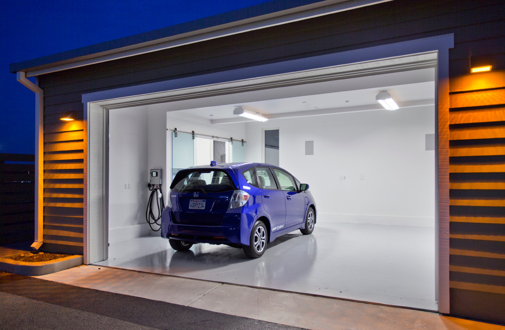 Example of a large trendy attached two-car garage workshop design in Sacramento
